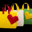Shopping bags with heart. Isolated origami — Stock Photo