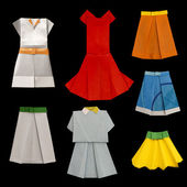 Set of Dresses and Skirts made of paper — Stock Photo