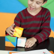 Royalty-Free Stock Photo: Boy playing with multicolored cubes