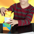 Boy playing with multicolored cubes — Stock Photo