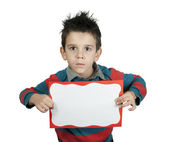 Boy with serious look who holds white board. — Stock Photo