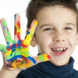 Boy hands painted with colorful paint — Stock Photo #16232101