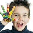 Boy hands painted with colorful paint — Stock Photo #16232103
