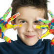 Boy hands painted with colorful paint - Stock Photo