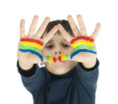 Boy hands painted with colorful paint — Stock fotografie