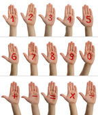 Children's hands with numbers — Stock Photo