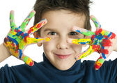 Boy hands painted with colorful paint — Stock Photo