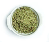 Dried oregano in a bowl — Stock Photo