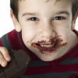 Smiling little boy eating chocolate — Stock Photo #16946533