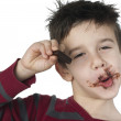 Smiling little boy eating chocolate — Stock Photo #16946599