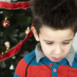 Unhappy little boy on christmass — Stock Photo #16946663