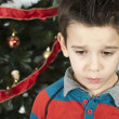 Unhappy little boy on christmass — Stock Photo #16946669
