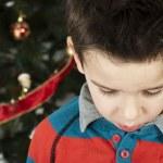 Unhappy little boy on christmass — Stock Photo #16946671