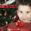 Happy child receive the gift of Christmas — Stock Photo