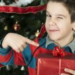 Boy points out his gift on Christmas — Stock Photo