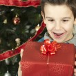 Stock Photo: Happy child receive the gift of Christmas