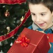 Happy child receive the gift of Christmas — Stock Photo #16946731