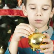 Little boy puts a coin in cash pig — Stock Photo #16946805