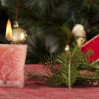 Christmas candle on the festive table — Stock Photo