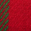 Handmade knit green and red background - Stock Photo
