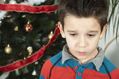 Unhappy little boy on christmass — Stock Photo