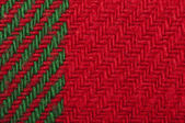 Handmade knit green and red background — Stock Photo