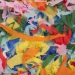 Many colorful pieces of torn paper — Stock Photo
