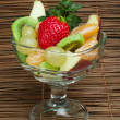 Fruit salad in a glass bowl — ストック写真