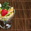 Fruit salad in a glass bowl — Stockfoto