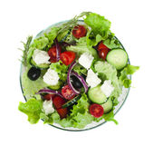 Salad in a glass bowl on a white background — Stock Photo