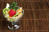 Fruit salad in a glass bowl — Stock Photo