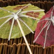 Colorful cocktail umbrellas — Stock Photo