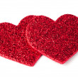 Red shiny hearts on white background — Stock Photo