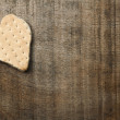 Heart shape cookie on wooden background - Stock Photo