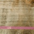 Stock Photo: Pink ribbon for gift wrap on wooden background