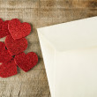 Red hearts and white envelope — Stock Photo