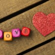 Word love on multicolored wooden cubes on wooden background — Foto de Stock