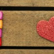 Stock Photo: Word love on multicolored wooden cubes on wooden background