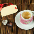 Cup of coffee with knitted heart symbol — Stock Photo