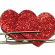 Two red hearts attached with a paper clip — Stock Photo