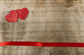 Red ribbon tape and hearts — Stock Photo