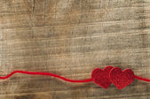 Red ribbon tape and two hearts — Stock Photo
