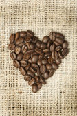 Heart made of coffee beans — Stock Photo
