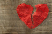 Heartbreak made of curled red paper — Stock Photo