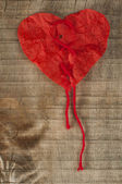 Heart made of curled red paper — Stock Photo