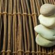 Stacked stones on wooden base — Stock Photo