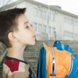 Boy with schoolbag - Stock Photo