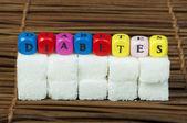 Sugar lumps and word diabetes — Stock Photo