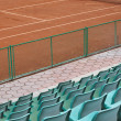 Grandstand seats and tennis court — Stock Photo