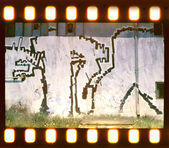 Aged street wall background. Film strip — Stock Photo